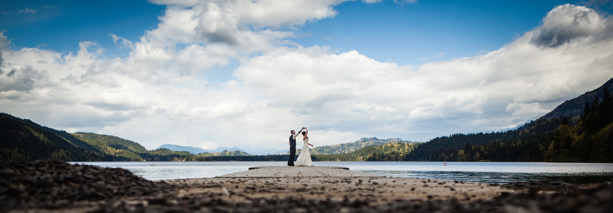 bride and groom dancing on a dock at cultus lake